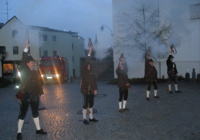 Traditional Bayern gun salute, outside the church in Marktl.
